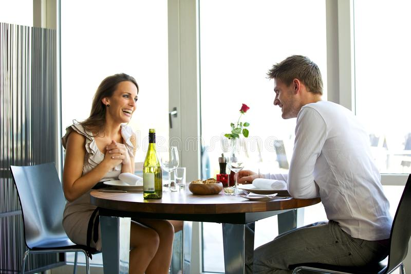 Couple Enjoying a Romantic Dinner for Two. Portrait of a couple enjoying each other's company in a romantic dinner royalty free stock photos