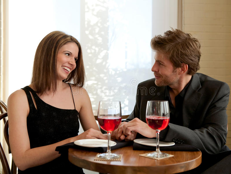 Couple Enjoying Selves at Restaurant stock images
