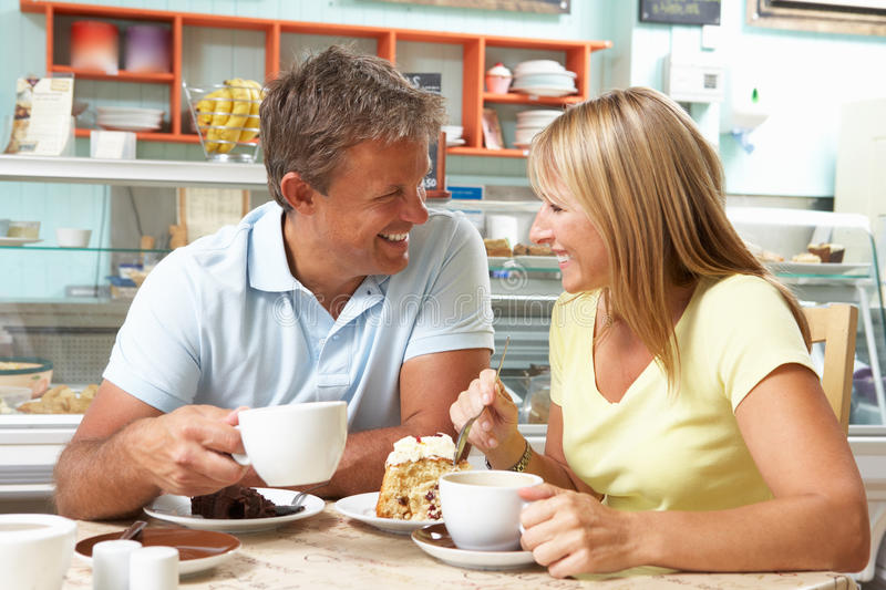 Download Couple Enjoying Slice Of Cake And Coffee In Cafe Stock Image - Image: 16054047