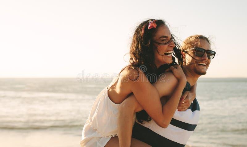 Couple enjoying summer holidays on beach stock image