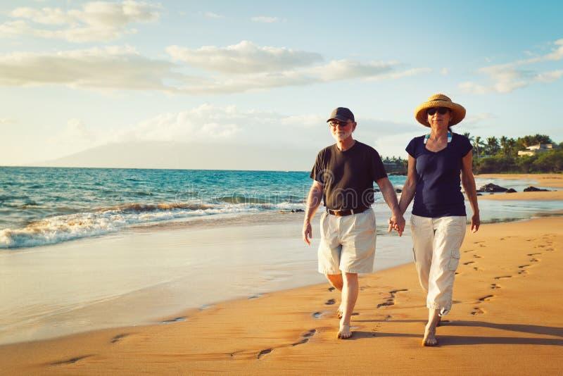 Download Couple Enjoying Sunset At The Beach Stock Photo - Image: 24146986