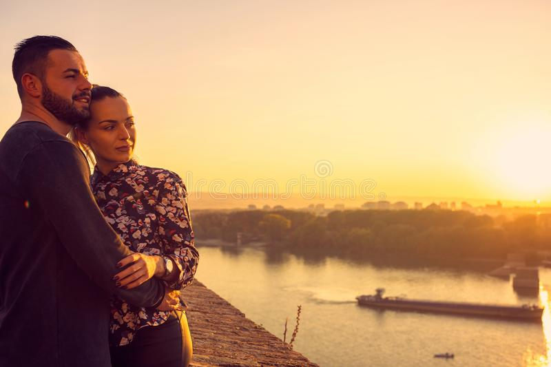 Couple Enjoying at sunset..Romantic  moment and love concept stock images