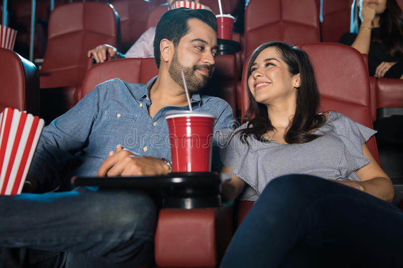 Couple enjoying their date at the movies stock image