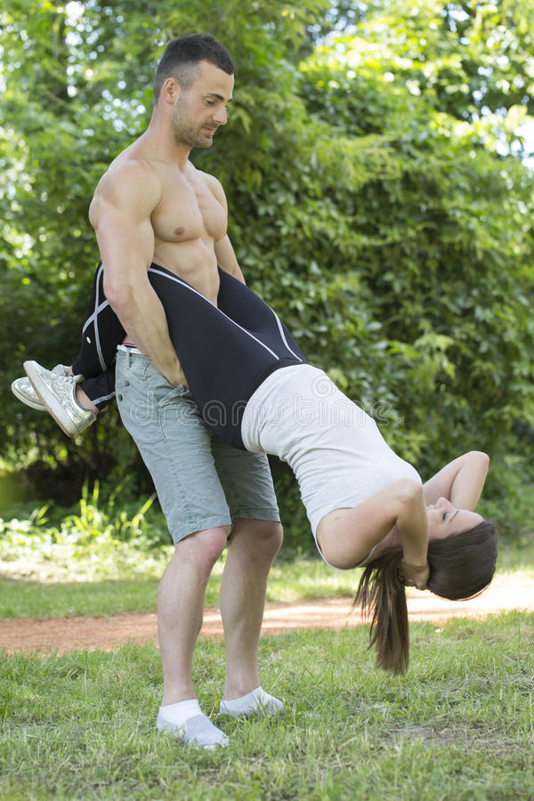 Couple enjoying time together while exercising outdoors stock images