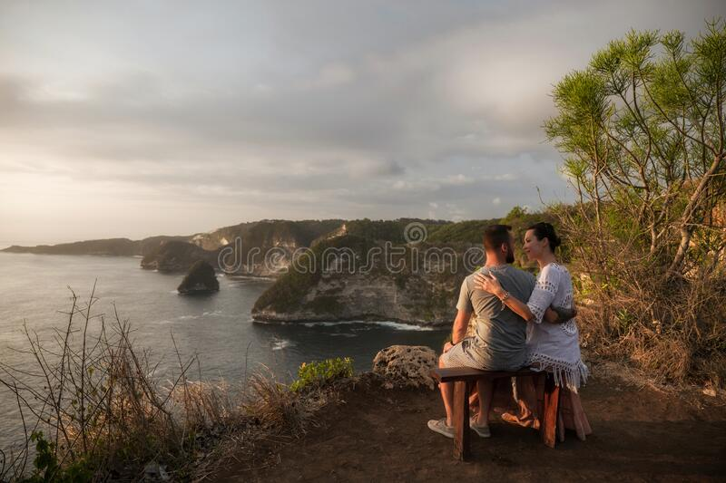 Couple enjoying view from Banah Cliff of Nusa Penida island, Indonesia stock images
