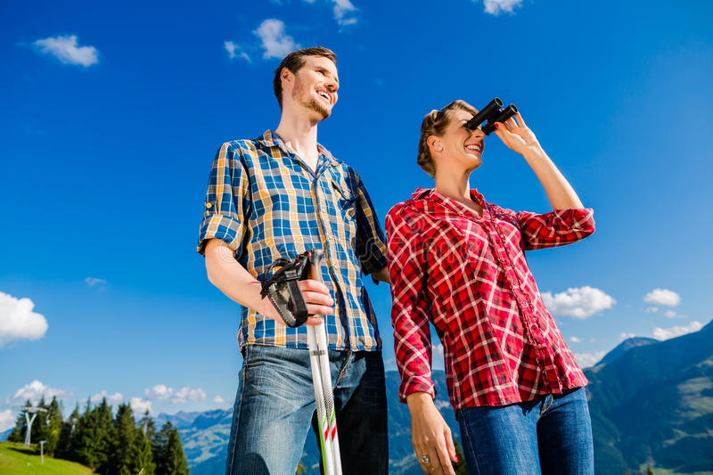 Couple enjoying view hiking in the alpine mountains stock images