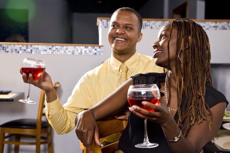 Couple enjoying wine in restaurant stock image