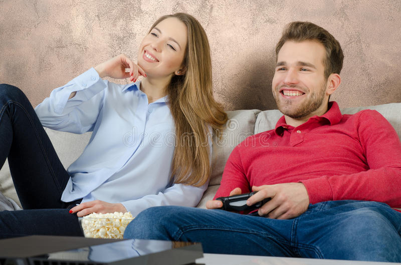 Couple enjoys free time and playing video games. royalty free stock photography