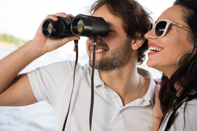 Men spending great time with his couple looking into binocularus stock photos