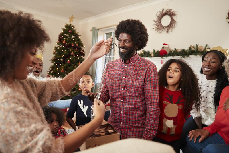 Couple Exchanging Gifts As Multi Generation Family Celebrate Christmas At Home Together royalty free stock photos