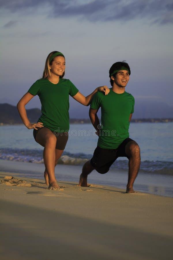 Download Couple Exercising On Beach At Sunrise Stock Image - Image: 18262401