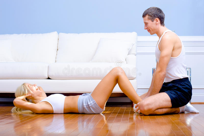 Couple Exercising On Living Room Floor Royalty Free Stock Photo