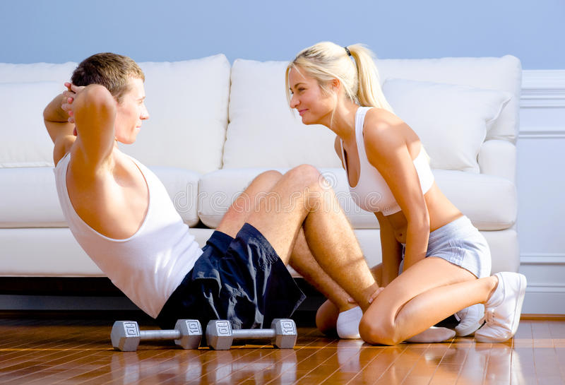 Download Couple Exercising On Living Room Floor Stock Image - Image: 12731627