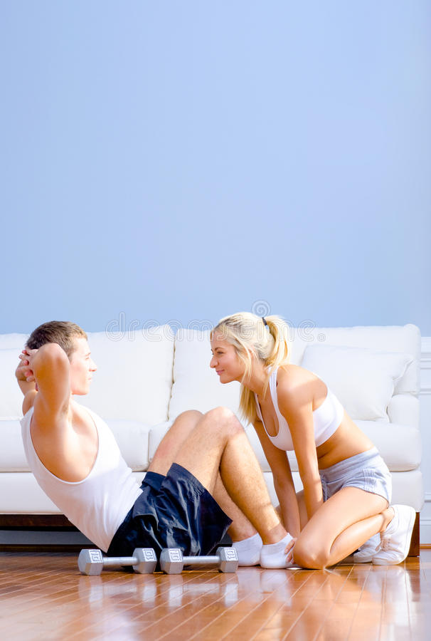 Download Couple Exercising On Living Room Floor Stock Image - Image: 12731633