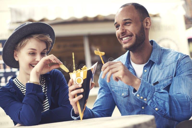 Couple exploring food truck royalty free stock photos