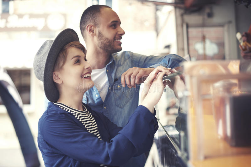 Couple exploring food truck stock image