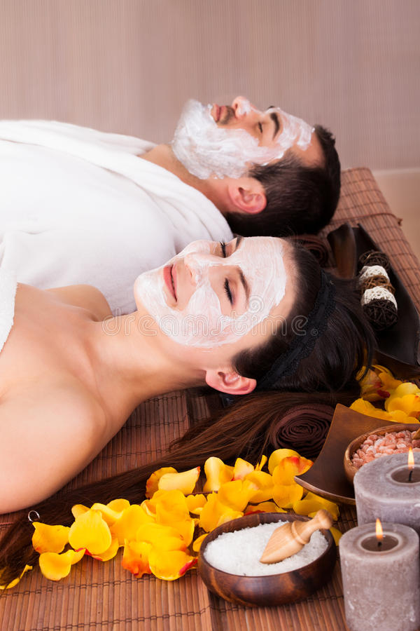 Couple with face mask. In Spa Centre royalty free stock photo