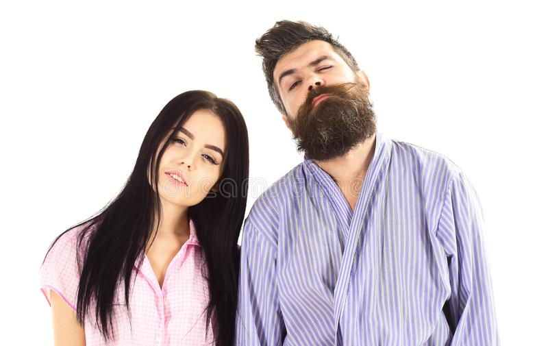 Couple, family on sleepy faces in clothes for sleep looks sleepy in morning. Couple hold hands together, isolated on. White background. Couple in love in pajama royalty free stock photo