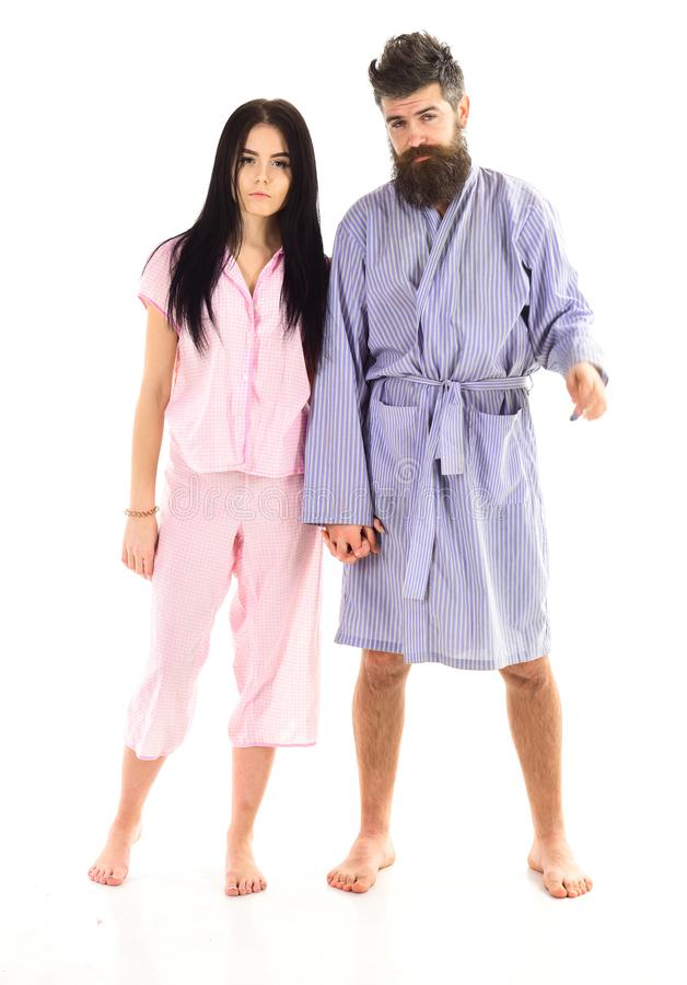 Couple, family on sleepy faces in clothes for sleep looks sleepy in morning. Couple in love in pajama, bathrobe. Insomnia concept. Couple hold hands together royalty free stock image