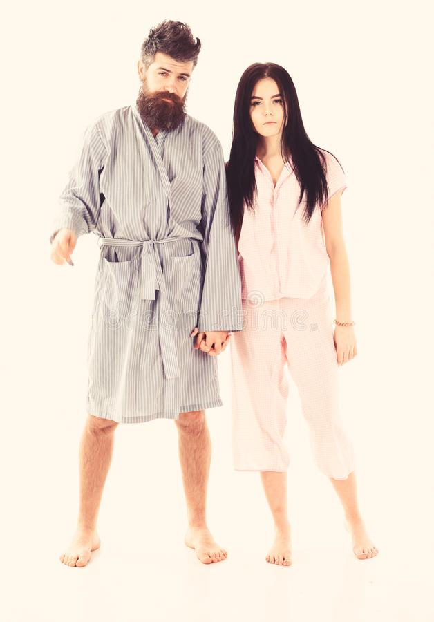 Couple, family on sleepy faces in clothes for sleep looks sleepy in morning. Couple in love in pajama, bathrobe. Insomnia concept. Couple hold hands together royalty free stock photos