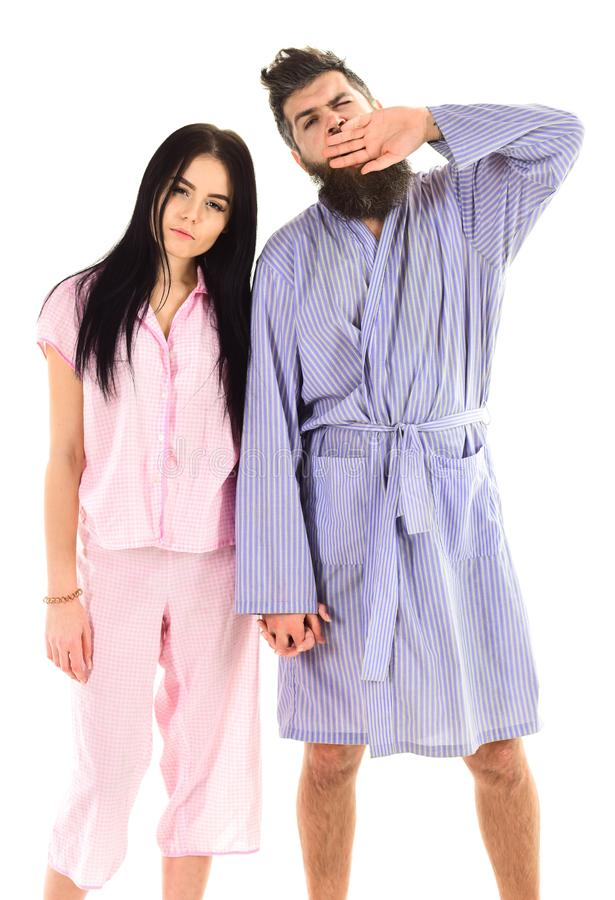 Couple, family on sleepy faces, yawning in clothes for sleep looks sleepy in morning. Insomnia concept. Couple in love. In pajama, bathrobe. Couple hold hands stock image