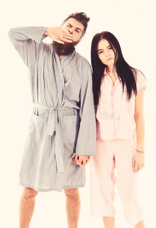 Couple, family on sleepy faces, yawning in clothes for sleep looks sleepy in morning. Insomnia concept. Couple in love. In pajama, bathrobe. Couple hold hands royalty free stock image