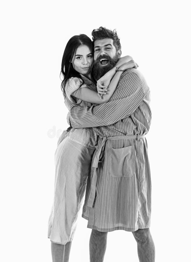 Couple, family on smiling faces in clothes for sleep looks happy in morning. Couple in love hugging in pajama, bathrobe. Perfect morning concept. Couple royalty free stock photos