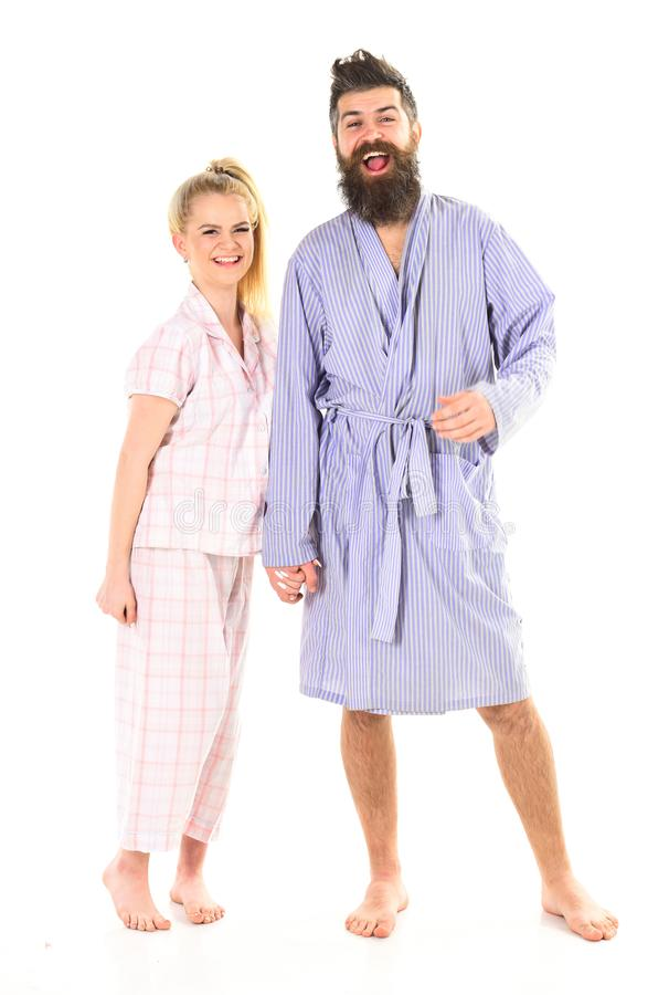 Couple, family on smiling faces in clothes for sleep looks sleepy in morning. Couple hold hands together, isolated on. White background. Couple in love in stock photos