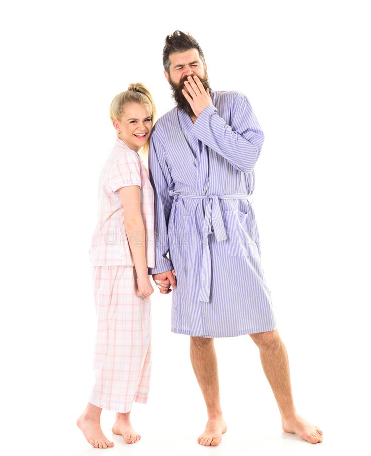 Couple, family on smiling faces in clothes for sleep looks sleepy in morning. Couple in love in pajama, bathrobe. Good. Morning concept. Couple hold hands stock photo
