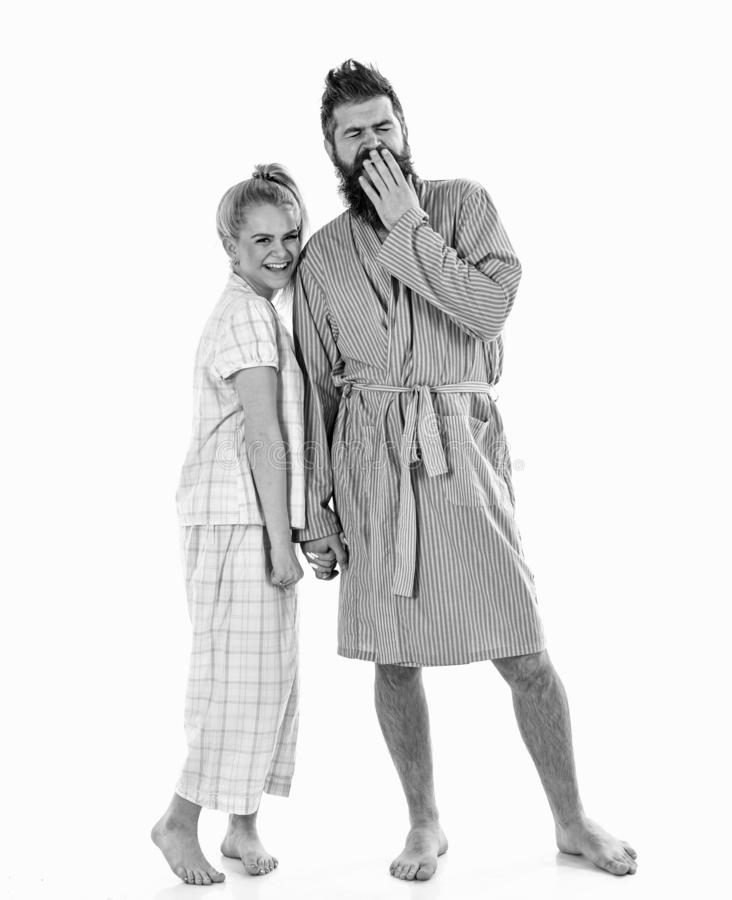 Couple, family on smiling faces in clothes for sleep looks sleepy in morning. Couple in love in pajama, bathrobe. Good. Morning concept. Couple hold hands royalty free stock image