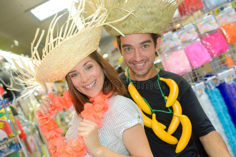 Couple in fancy dress straw hats royalty free stock image