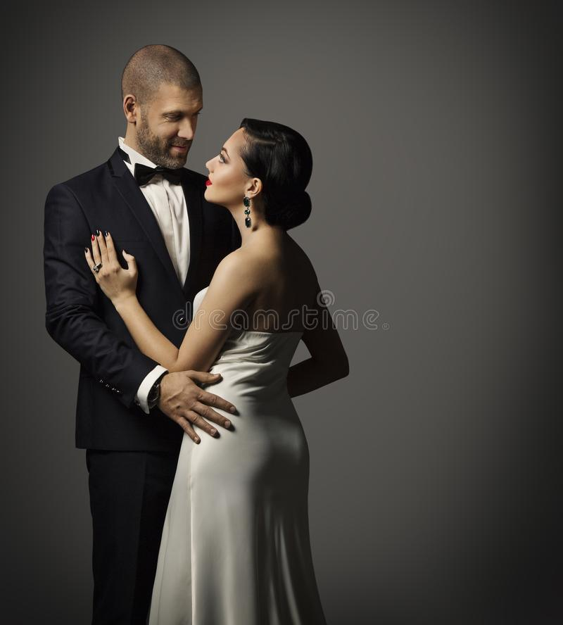 Couple Fashion Portrait, Embracing Man in Suit and Woman in Dress stock images