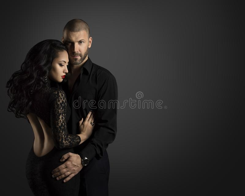 Couple Fashion Portrait, Young Man Embrace Woman in Black. Couple Fashion Portrait, Young Man Embrace Beautiful Woman in Elegant Black Dress royalty free stock photos