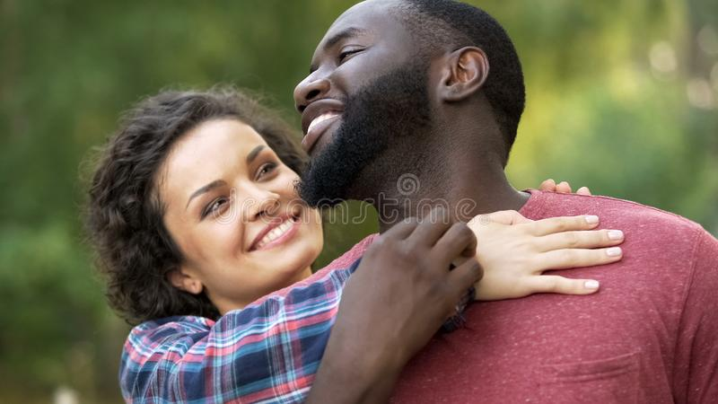 Couple feeling love and support of each other, multiethnic relations, family stock image