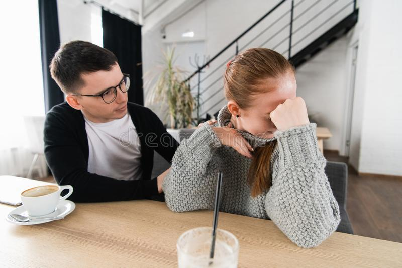 Couple fighting. A young man is trying to have a conversation, while he`s been ignored by his girlfriend stock images