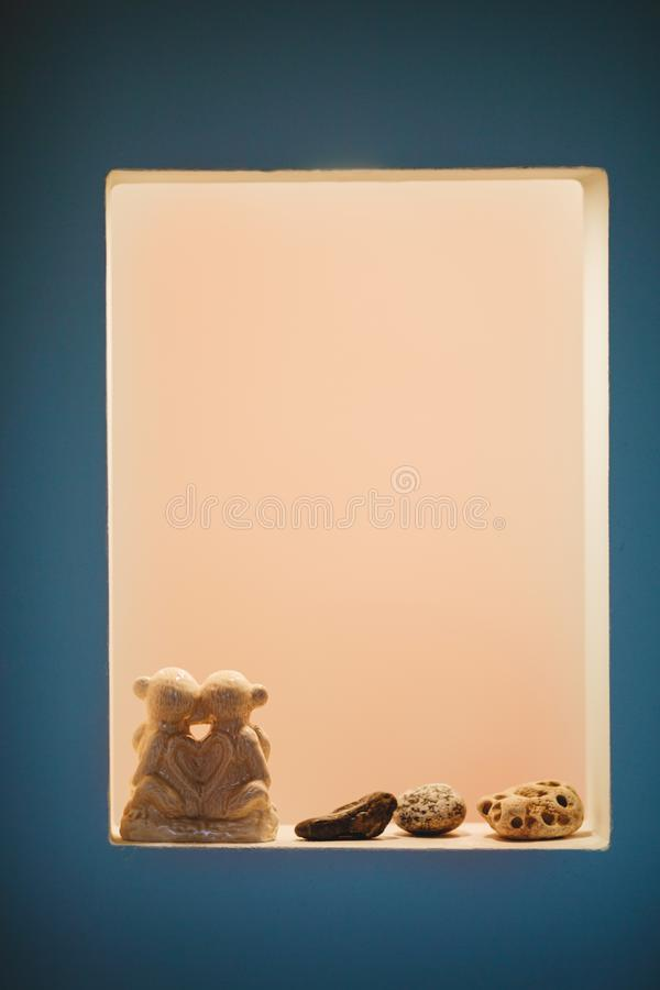 A couple of figures stand on a shelf stock photos