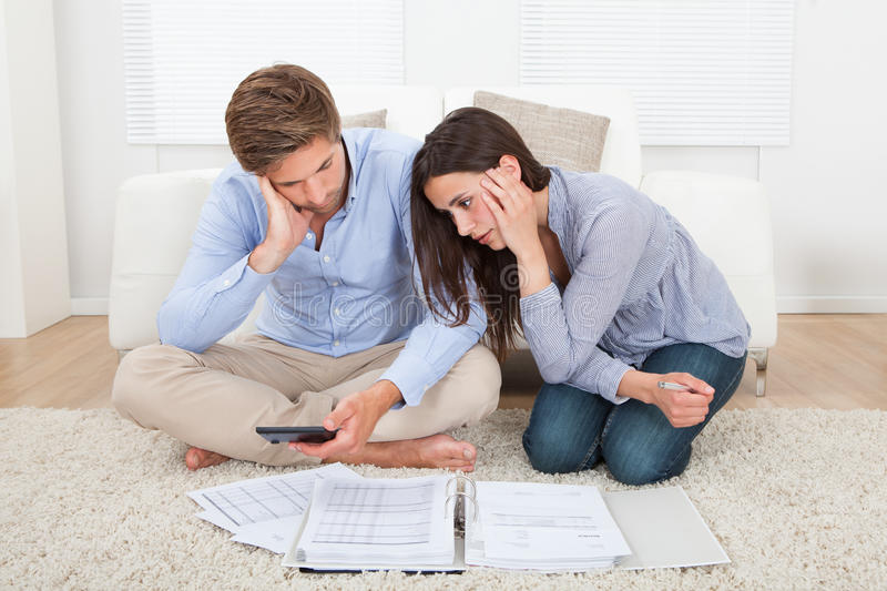 Couple in financial trouble at home stock photography