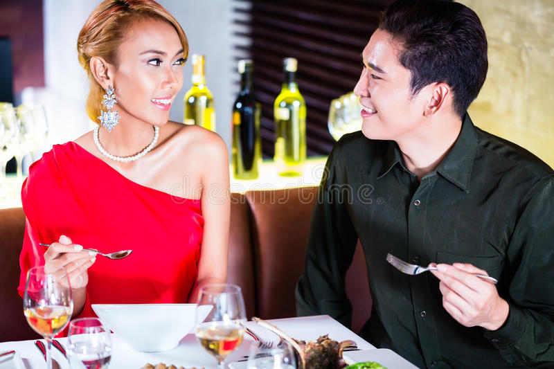 Couple fine dining in fancy restaurant. Asian couple fine dining in fancy restaurant royalty free stock image