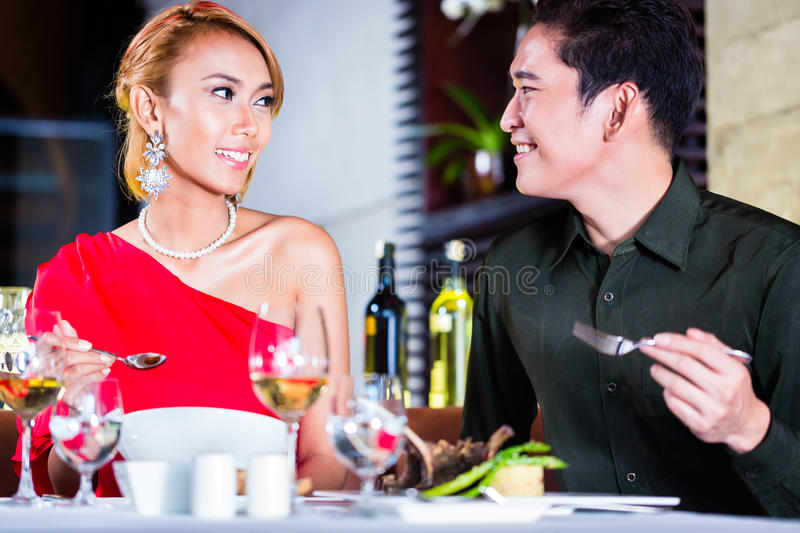 Couple fine dining in fancy restaurant. Asian couple fine dining in fancy restaurant royalty free stock photography