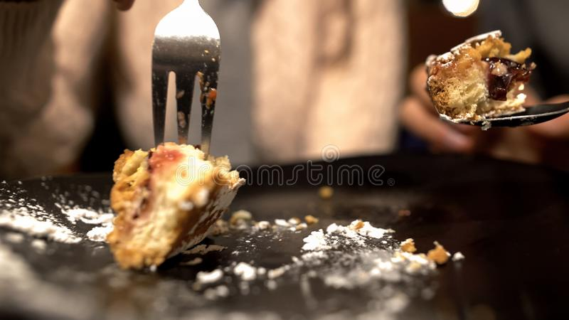 Couple finishing eating tasty pie in cafe, poor students on romantic date, meal. Stock photo royalty free stock photo