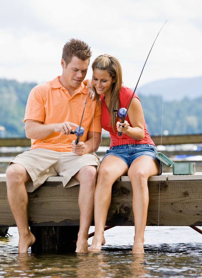 Free Couple Fishing On Pier Royalty Free Stock Photos - 7379238