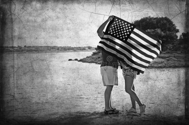 Couple flag. Couple kissing flag patriotic summer stock photography