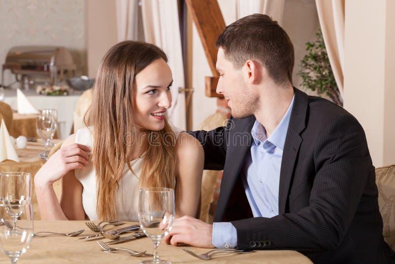 Couple flirting in restaurant stock image