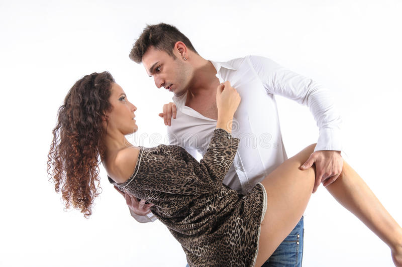 Couple flirting in sensual position. Couple flirting or dancing in position isolated over white background stock photos