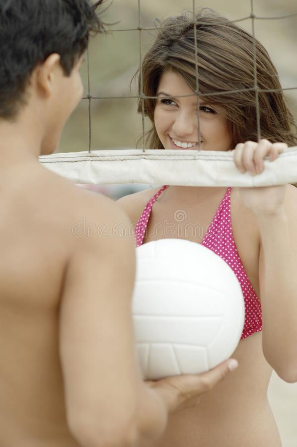 Couple Flirting by Volleyball Net royalty free stock images