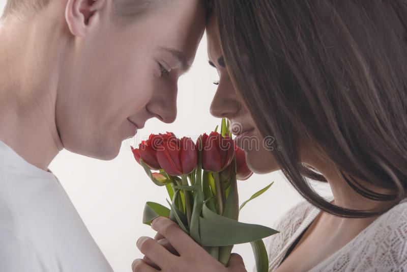 Couple with flowers stock images
