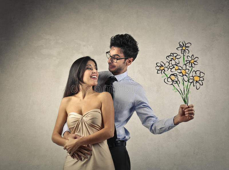 Couple with flowers stock image