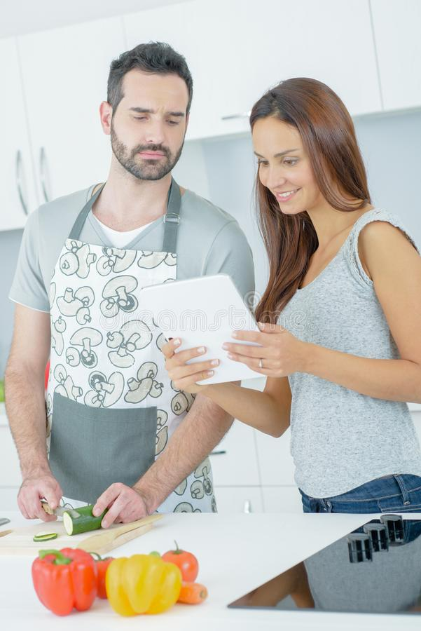 Couple following a recipe royalty free stock photo