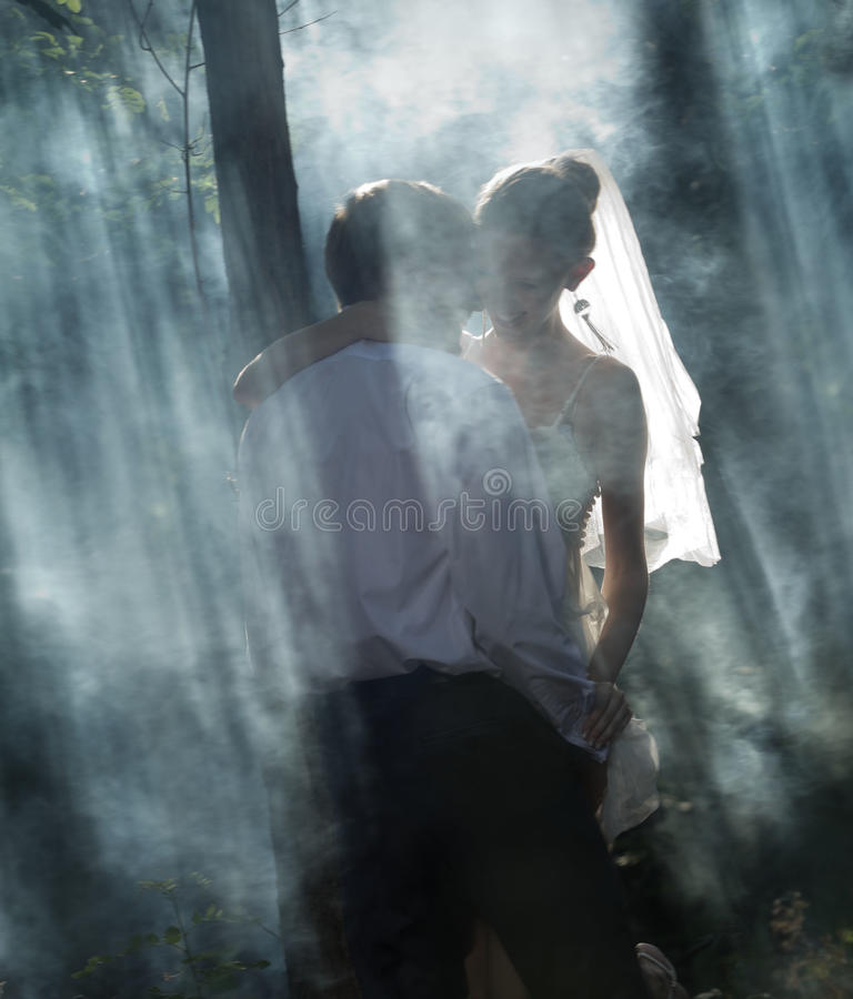 Couple in a forest stock photos