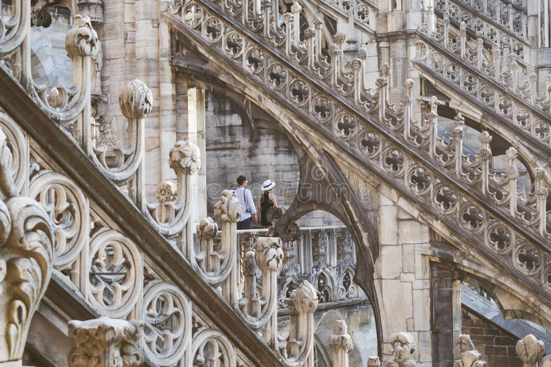 Couple framed in the gothic arches of the Duomo di Milano. Couple framed in the gothic arches of the Duomo di Milano, Italy royalty free stock photo
